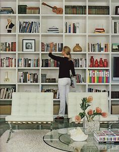 I want a wall of books and such like this.  And my books will all be color coded and glorious!  Even if Jennifer makes fun of me for doing it.<---okay idk about the color coding and such but this would be awesome to DIY with shelves or just wood to make it look built in