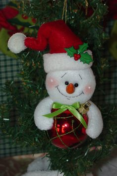 Items similar to Snowman Holding Christmas Ornament on Etsy