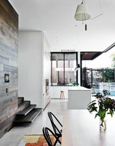 This Victorian house has been extended & renovated, with the architects cleverly combining traditional style with contemporary design. Beautiful timber walls & floors …. love the concrete floors & blu
