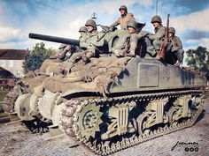 US Infantry riding on an M4 Sherman tank of the 33rd Armored Regiment, 3rd Armored Division in Stolberg, Germany. 14 October, 1944