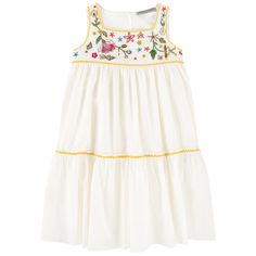 Right side: Cotton voile Cotton voile lining Dress: Light and flowing Square neckline Sleeveless Very flared bottom Loose fit Button in the neck Rick-rack braid on the trims Embroidered flowers Small rocaille pearls - 223,00 €