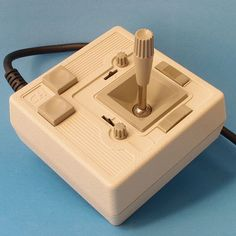 CH Products Mach II Analog Joystick :-: One of the early analog type joysticks of the early 1980's, this device was main used on PCs. Its connection was using 15 pins (DA-15) while the more popular joysticks of the age sported a DE-9. Being analog, control using this joystick was a lot harder.