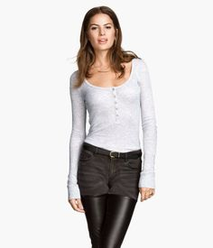 Fitted top in slightly sheer, rib-knit jersey with a scoop neck, buttons at front, and long sleeves.