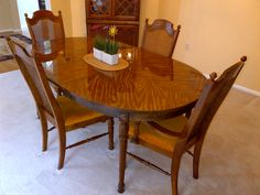 Dining room table and chairs in oarkahuna's Garage Sale in Wildwood , MO for $500. Very nice dining room table and 4 chairs with leaf for extension of table.  Chair have wicker style backing with auburn fabric cushions.  Table has very nice shine and is solid.  Moving to a home with no formal dining area. Make offer.