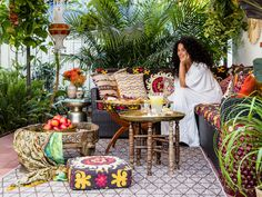 Take a cue from designer Justina Blakeney and turn your backyard into an exotic retreat