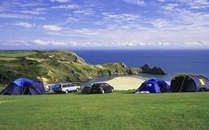 The Three Cliffs Bay Holiday Park in Gower, UK spans 52 acres of of cliff/land and access to a golden beach!