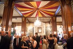 Cocktail hour in the John Eager Howard Ballroom.  This ballroom was originally the Belvedere Hotel's tea room and features a working marble fireplace, upholstered ceiling, five crystal chandliers, and murals painted on Japanese rice paper  |  Belvedere & Co. Events  |  Sachs Photography
