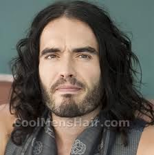 The reason I love Russell Brand is his great personality & warm heart. He is one of a kind. What a wonderful singer & comedian! Russell Brand, Long Wavy Hair, Big Hair, Hair Styles 2014, Long Hair Styles, Old Hairstyles, People Crowd, Long Faces, White Teeth