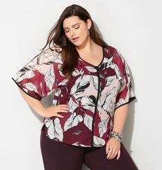 Shop beautiful, flowy blouses in sizes 14-32 like the plus size Trimmed Leaf Kimono Blouse available online at avenue.com. Avenue Store