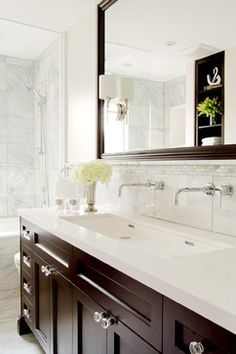 White brick mother of Pearl Tile Design accent above the backsplash tile. The perfect touch!