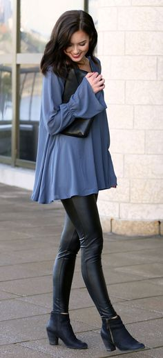 Blue bell sleeve tunic from Show Me Your Mumu is perfect with a delicate gold necklace and red lipstick - paired with coated leggings and a black clutch by fashion blogger Marie's Bazaar.