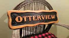 "Premium cedar carved sign with Sikkens finish. By Adirondack Jim's Carved Signs. 11"" by 32"" by 1 1/5""."
