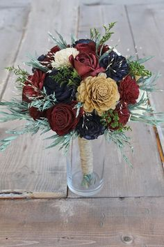 This beautiful sola wood flower bouquet was meticulously crafted with various, natural cream & gold accent sola flowers, burgundy, & navy blue, then accentuated with more preserved flowers & eucalyptus leaves. The stem is wrapped with jute twine; more options available from the drop down menu. Perfect for any wedding theme! Need more color?? The sola wood flowers can be MADE TO MATCH your color scheme as well. Please send your request This beautiful bouquet would also make except...