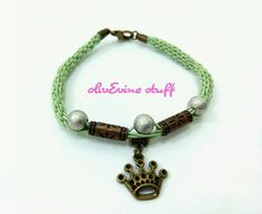 Green bracelet with crown