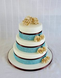 Teal color with black or silver trim with either white roses or lillies. Elegant Modern Blue Gold Round Wedding Cakes Photos & Pictures - WeddingWire.com