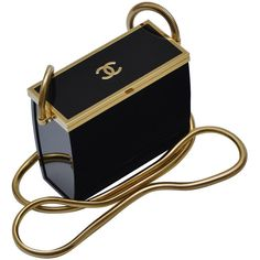Pre-owned Rare Chanel Black Lucite Mini Handbag ($4,875) ❤ liked on Polyvore featuring bags, handbags, clutches, purses, evening bags and minaudières, handbags and purses, pre owned handbags, chanel, handbags & purses and lucite purse