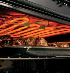 """With the Ten-Pass Dual Broil Element on our GE Profile Series 30"""" Built-In Double Convection Wall Oven, you'll get the most even cooking temperatures on all your dishes this holiday season."""