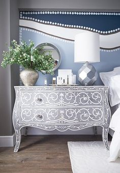 Short on bedroom storage? Flank the bed with dressers that double as nightstands, as Andrew does in Kim's bedroom with a pair of bone-inlay chests.