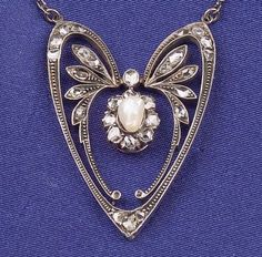 Art Nouveau Diamond and Freshwater Pearl Pendant Necklace, centering a pearl drop highlighted by thirty rose-cut diamonds, silver-topped 14kt gold mount, suspended from a sterling silver trace link chain, lg. 16 1/2 in.