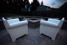 Relax by the fire pit.  Outdoor Living by Wildwood Land Design.  We isntalled the pavers, fire pit, seat wall and lighting to dramatically change this outdoor space.