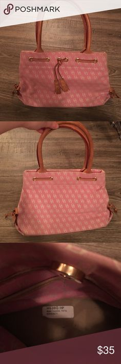 Dooney & Bourke Mini Tassel Tote Dooney & Bourke Mini Tassel Tote: gently used pink Handbag. The bottom corners do show a little wear but overall it is in good condition. It does not have any stains or markings on the inside of the purse. Dooney & Bourke Bags