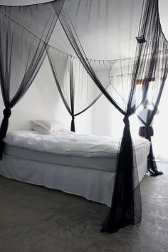 Contrast simple white bedding with a sheer black bed canopy. Adds the perfect amount of mysterious, understated, and edgy glamour to the bedroom.