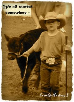 This will be one of our grand daughter's or both, showin grandpa's cattle, and nana  taking pictures