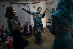 Female Syrian #refugees dance at a wedding celebration in the informal Marj El-Khokh refugee camp, southern #Lebanon. © UNHCR/L.Addario