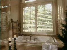 The first thing that greets you upon entering the master bath is the huge step-up tub with a large window and fantastic view. The window is shuttered, enabling you to opt for the view or for privacy.