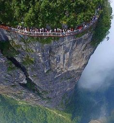 Travel with Travelon bags!Glass walkway that runs along the side of Tianmen Mountain in Zhangjiajie National Forest Park - China Zhangjiajie, Places Around The World, Around The Worlds, Scary Bridges, Tianmen Mountain, Places To Travel, Places To Visit, National Parks, Amazing Nature