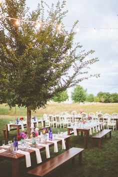 Outdoor setting with long wooden tables and benches #wedding #gardenparty #gardenwedding #reception #tablescapes