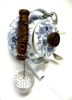 You need to go to the etsy store to see more photos of this teapot bird house
