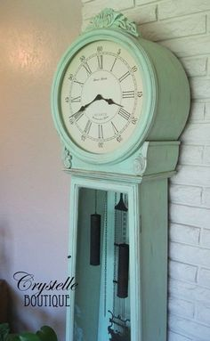 mint green grandfather clock. Wouldnt do the green but I like the face style and black mechanisms.