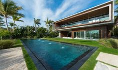 The home comes complete with a heated salt water pool adjacent to home's shoreline and a natural 100-feet-long swimming lagoon with an organic filtration system filled with live fish.