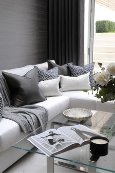th2 Designs.© This corner sofa is adorned beautifully with scatter cushions, highlighting the the blue and grey tones.