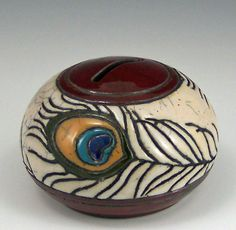 Japanese raku pottery and peacock feathers are just awesome