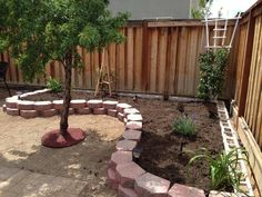 Raised flower bed. Looks like the back side is lined with cinder blocks! Might have to try this