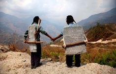 Child slaves (bonded) - May14 - BROTHERS CARRYING STONE, NEPAL  Each day, children make several trips down the mountain, delivering stones from higher up in the Himalayas. ...