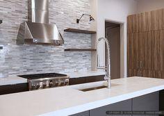 Dark kitchen cabinets, white quartz countertop with modern subway marble kitchen…