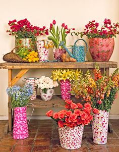 Flowery Fun... change containers up from season to season! What a fresh greeting for guests in my porch!  #FlowerShop