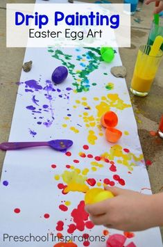 Drip Painting with plastic Easter eggs for a process art experience