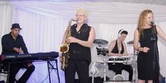 Abbey Artico on sax. With wedding band