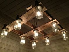 An up-cycled pallet and mason jars make for a unique light fixture.