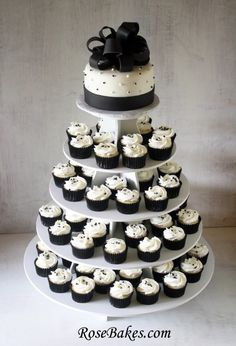 Black & White Wedding Cake & Cupcake Tower to look like a tiered wedding cake. Top cake for cake cutting and cupcakes for the rest of the guests to enjoy White Wedding Cupcakes, Black And White Cupcakes, Black And White Wedding Cake, White Cakes, Black White, Cupcake Wedding, Purple Wedding, Gold Wedding, Wedding Table