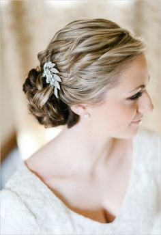 Low Twisted Bun and hair off the face!  Crucial for a wedding in July :)