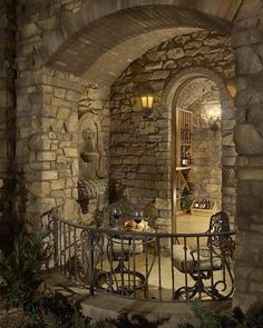 Wine room patio with stone wall fountain.