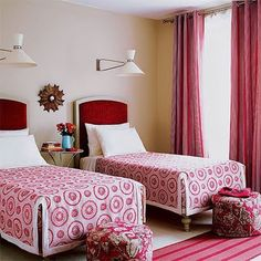 Guest room with twin beds. Sconces centered over beds