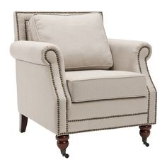 "Lenox Arm Chair  •Construction Material: Wood and fabric  •Color: Beige  •Features: •Cushioned back  •Traditional English caster feet  •Nailhead trim     •Dimensions: 35"" H x 30.5"" W x 31.5"" D                                        $340.95"