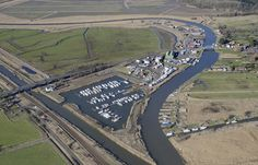 The Haddiscoe or New Cut is on the left. The canal opened in 1833 to connect Lowestoft to Norwich, thereby bypassing Great Yarmouth. Great Yarmouth, Aerial Images, Viking Tattoos, Fields, City Photo, Connection, Novels, Old Things, Tower