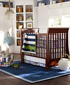 Alligator Nursery | Pottery Barn Kids.  Seriously love the dark navy and green.  Hmm.  Could I do a navy and green GIRL's nursery?  And no, Lois, I have NO IDEA (yet ;))